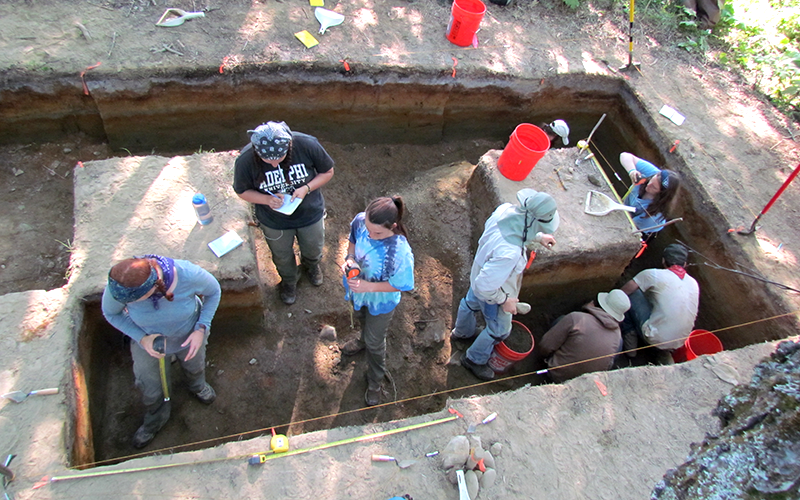 Adelphi anthropology students digging on site